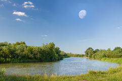 Moon over the summer river. Stock Photo