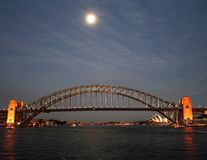 Moon over Sydney Harbour. Moon rising over Sydney Harbour Bridge Stock Image