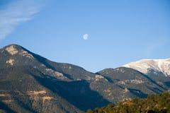 Moon Over The Rockies Stock Photos
