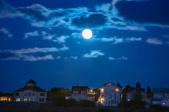 Moon over the town Stock Image