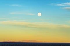Moon Over Uyuni Royalty Free Stock Photos