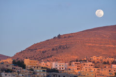 Moon over Wadi Musa, Jordan. Known worldwide for the ancient city of Petra Royalty Free Stock Photo