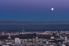 Moon over Warsaw city Stock Photo