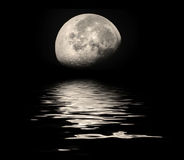 Moon over water. With reflection or can be cut out and used to add to other images Stock Photography