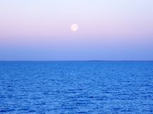 Moon over the water. Full moon over the water Royalty Free Stock Image
