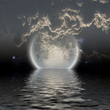Moon over water. With low clouds Royalty Free Stock Photography