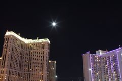 The moon between the palaces. In Las Vegas Stock Photo