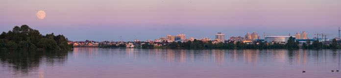 Moon perigee seen from Minsk, Belarus. City Scape at evening scene with super moon. Fullmoon in Minsk, panoramic view of the city Stock Photo