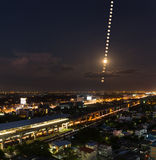 Moon Phases , moon trail over the city pf Bangkok, Thailand- Nig Stock Images