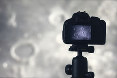 Moon photography. Camera with tripod capturing moon. Archimedes Royalty Free Stock Photography