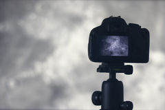Moon photography. Camera with tripod capturing moon.  Crater Era Royalty Free Stock Photography