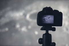 Moon photography. Camera with tripod capturing moon.  Moon Crate Royalty Free Stock Image