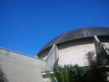 Moon at Planetarium. Micro moon viewed from outside a planetarium with no clouds Royalty Free Stock Images