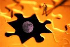 Moon puzzle problem. Loneliness in problem solving concept Royalty Free Stock Photography