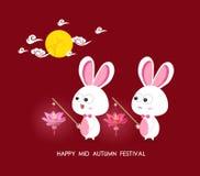 Moon and Rabbits holding lotus lanterns of Mid Autumn Festival Royalty Free Stock Photo
