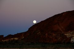 Moon at Rainbow valley, Southern Northern Territory, Australia Royalty Free Stock Photography