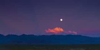 Moon from red cloud. When sunset Royalty Free Stock Images