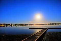 Moon reflected on a lake Stock Photos