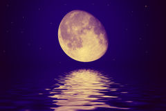 The moon is reflected in a wavy wate Royalty Free Stock Image