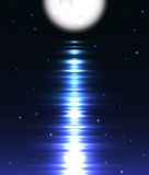 Moon reflection over water against black Royalty Free Stock Photo
