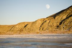 Moon rise 2. Full moon rising over a frozen river Stock Image