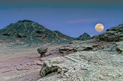 Moon rise in desert, Israel. Classical biblical landscape in the Negev desert, Israel, 25 miles north of Eilat Stock Photo