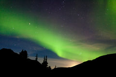 Moon rise hills northern lights Aurora borealis Royalty Free Stock Photos
