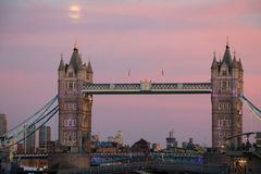 Moon rise at London Bridge Stock Image