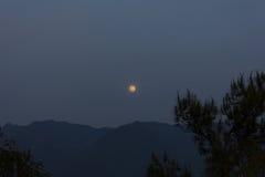 Moon Rise over a Mountain Stock Photo