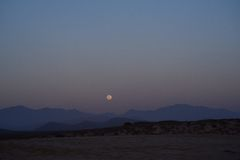 Moon rise over the mountains in Baja California Stock Photo