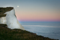 Moon rise over Seven Sisters landscape, Sussex, England Stock Photo