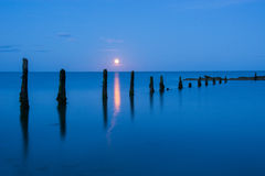 Moon rise on Pilmore Strand Stock Photography