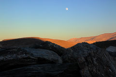 Moon rise. S over the hills Stock Image