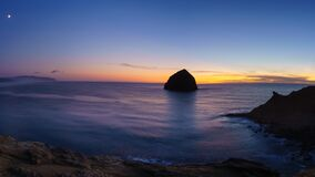 Moon rise and sunset over Cape Kiwanda