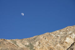 Moon rised over mountains Royalty Free Stock Image