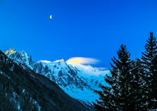 Moon rises above the Mount Blanc in France Royalty Free Stock Image