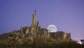 Moon Rises over Superstition Mountains. Moon over Superstition Mountains in Arizona. Picture taken at Lost Dutchman, a State Park east of Phoenix royalty free stock images