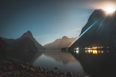 Moon rising above the peaks of Milford Sound, New Zealand royalty free stock image