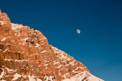The moon rising behind the mountain Stock Photos