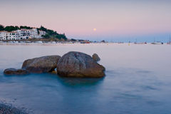 Moon rising in the Mediterranan sea Royalty Free Stock Images
