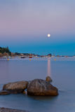 Moon rising in the Mediterranan sea Stock Image