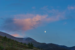 Moon rising over the Cairngorm mountains Stock Photos