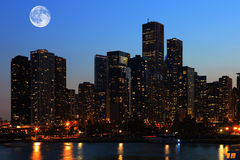 Moon rising over Chicago, Illinois Royalty Free Stock Photography