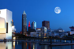 Moon rising over Cleveland, Ohio stock photos