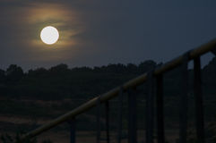 Moon rising over the hill Royalty Free Stock Images
