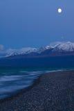 Moon rising over Kluane Lake near Kluane National Park Royalty Free Stock Images