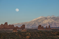 Moon rising over La Sal Mountain Moab Utah Stock Image
