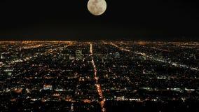 Moon rising over la timelapse stock video