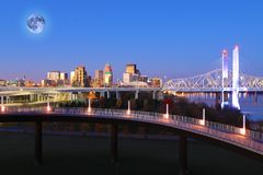 Moon rising over Louisville, Kentucky stock images