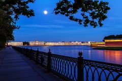 Moon rising over Neva river waterfront stock photography